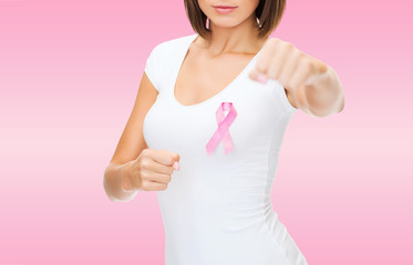 close up young woman with cancer awareness ribbon