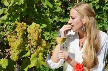 Woman tasting wine. Lavaux region, Switzerland