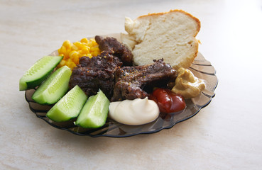 Plate with a variety of food on the table