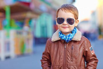 portrait of smiling boy walking on the street