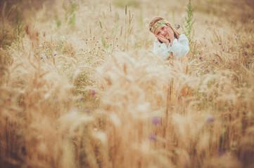 Girl in folk costume in a field