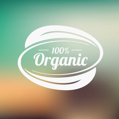 Organic product badge on blurred landscape. Vector illustration