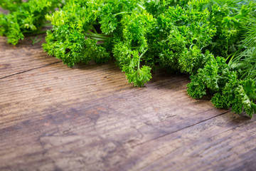Parsley and dill on wooden table