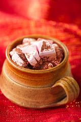 hot chocolat vintage mug on red glitter backdrop