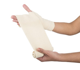 Woman wrapping her hand with a bandage isolated