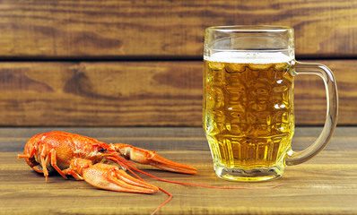 Tasty boiled crayfish and beer on table
