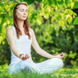 Yoga outdoors. Woman meditating in lotus position. Relaxation