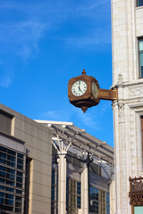 Clock on the corner of historic building in Washington DC