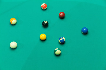 Breaking Pool Balls on green table