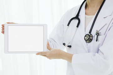 Women doctors have a tablet