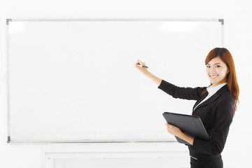 asian smiling business woman teaching with a white board