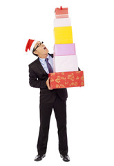 surprised businessman holding gift boxes . isolated on white