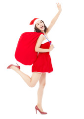 young female holding a gift bag with Christmas suit running and