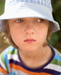 Portrait of a Boy with Blond Hair and Hat