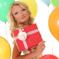 party girl on the background balls with gift box