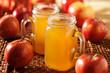 mason jars filled with hot apple cider - 70925535