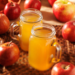apple cider with focus on the top of both mason jars