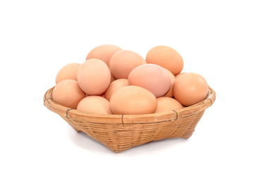 eggs  in the basket on white background