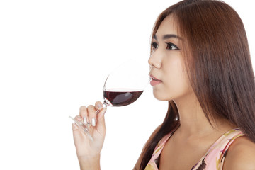 Beautiful Asian woman drink red wine