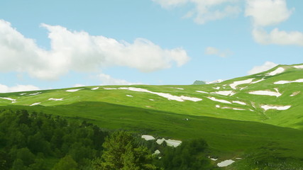 Timelapse of white cloud at sunny day in the mountain valley