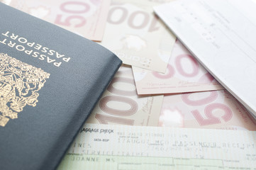 Canada passport with boarding pass on the table
