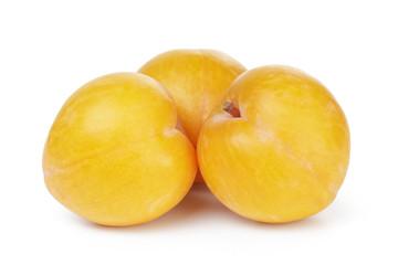 three yellow plums