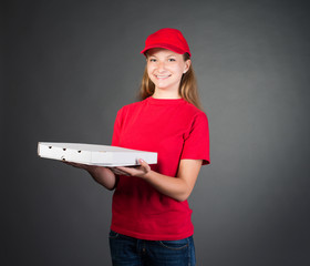 Pizza girl in red uniform delivering pizza isolated on grey