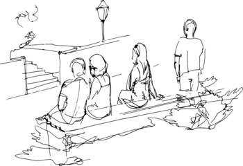 group of people relaxing on a park bench