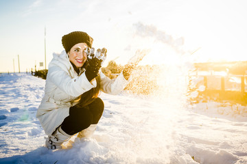 Woman Having Fun with Snow