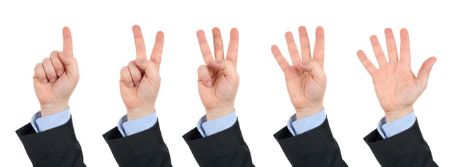 businessman's hand, counts on fingers from one to five