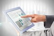 Leinwandbild Motiv Composite image of businesswoman using a tablet pc