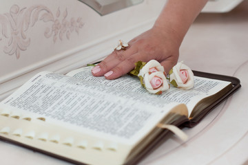 beautiful rose and hand on the open book