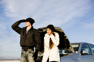 Desperate couple with Car Problem during a cold winter day