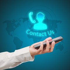 Businessman showing smartphone with  word contact us and icon on