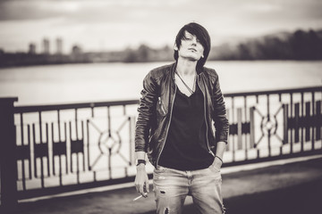 Young beautiful short hair woman at the embankment