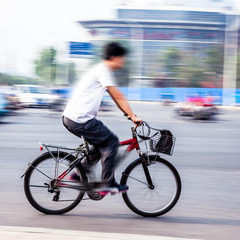 bicycle riders in the city in motion blur