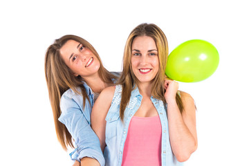 Friends with balloons over white background