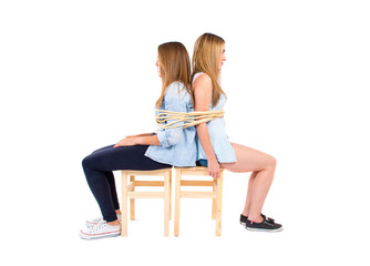 Sisters kidnapped and tied to a chair