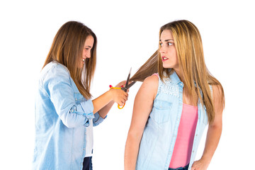 Girls with scissors over white background