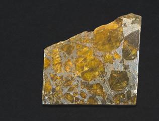 Slice of Pallasite meteorite, Belarus, 1810. 4cm across.