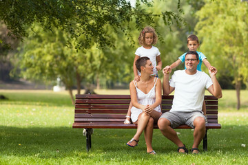 Happy family playing in a park.