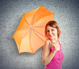 Girl holding an umbrella over textured background