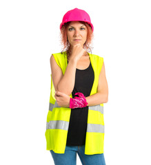 Worker woman thinking over isolated white background