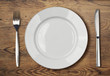 white empty dinner plate setting on wooden table - 70935934