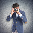 Man photographing over textured background
