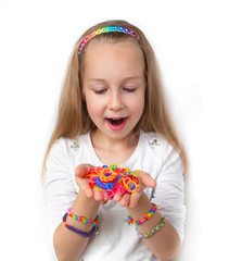 Little girl holding loom bangs and demonstrating her craft work