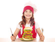 hungry little girl cook with big hamburger
