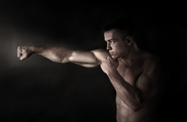 Boxer fighter on black background