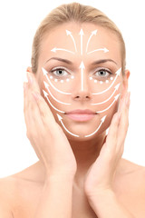 Face massage.Beautiful woman's face, isolated