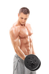 Handsome shirtless man exercising with a barbell